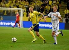 Sweden national team striker John Guidetti and Russia national team midfielder Yury Gazinsky. Solna, Sweden - November 20, 2018. Sweden national team striker stock photography