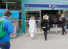 Solna railroad station entrance. Solna, Sweden - September 14, 2016: People walking towards the entrance of the Solna comuter train station royalty free stock photo