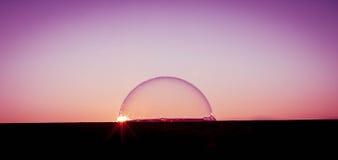 Solnedgång över bubblavärlden Arkivbilder