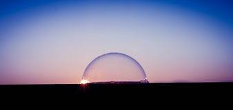 Solnedgång över bubblavärlden Royaltyfri Foto