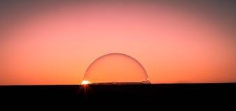 Solnedgång över bubblavärlden Arkivfoto
