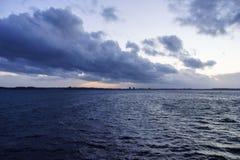 Solnedgång över den Kiel fjorden efter en storm Fotografering för Bildbyråer
