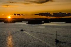 Solnedgång över en bro Royaltyfria Foton
