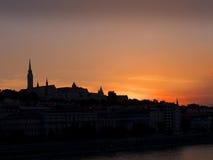 Solnedgång över flodDonauen i den Budapest Ungern Fotografering för Bildbyråer