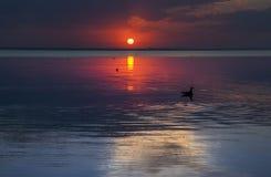 Solnedgång över floden Fotografering för Bildbyråer