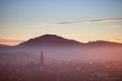Solnedgång över Freiburg, Tyskland royaltyfri foto