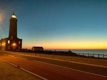 Solnedgång över fyren fotografering för bildbyråer