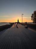 Solnedgång över fyren Arkivbilder