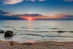 Solnedgång över havet och himlen Fotografering för Bildbyråer