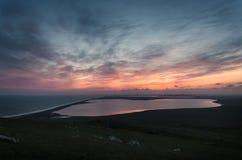 Solnedgång över havet och sjöarna Royaltyfria Bilder