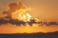 Solnedgång över Islay från den Islay färjan Royaltyfri Bild