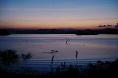 Solnedgång över laken Royaltyfria Bilder