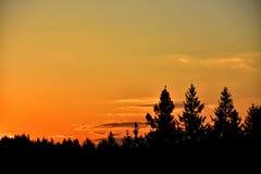 Solnedgång över landet Arkivfoton