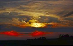 Solnedgång över landskapet Royaltyfria Foton