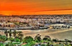 Solnedgång över Msida - Malta royaltyfria foton