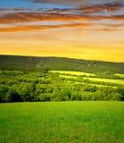 Solnedgång över nationalparken Sumava Royaltyfria Bilder
