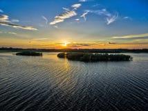 Solnedgång över sjön i Brabrand Royaltyfria Foton