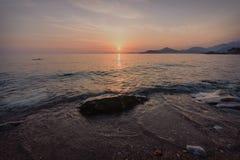 Solnedgång över St Stephen ` s i Montenegro Royaltyfri Foto