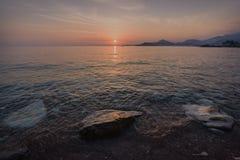 Solnedgång över St Stephen ` s i Montenegro Fotografering för Bildbyråer