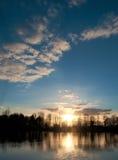 Solnedgång över styrman damm Royaltyfria Bilder