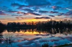 Solnedgång över styrman damm Royaltyfri Foto