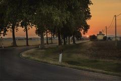 Solnedgång över vägen - Tuscany Fotografering för Bildbyråer