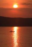 Solnedgång av Jingpo laken Arkivfoton