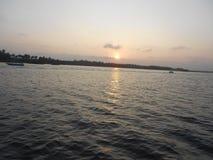 Solnedgång avkrok i Puducherry, en tyst liten stad på den sydliga kusten av Indien Fotografering för Bildbyråer