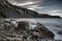 Solnedgång bak den höga klippan av Izola, Slovenien Fotografering för Bildbyråer
