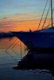 Solnedgång bak fartygen Royaltyfri Fotografi