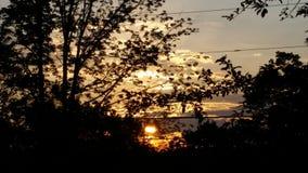Solnedgång eller soluppgång? Arkivfoto