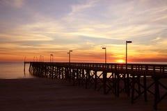 solnedgång för 2 pir Royaltyfri Bild