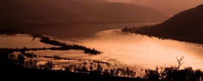 solnedgång för 3 liggande Arkivfoto