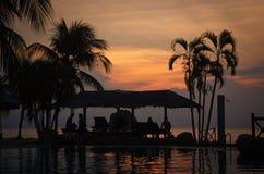 solnedgång för 3 pöl Arkivbild