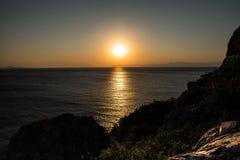 Solnedgång för Aegean hav arkivbild