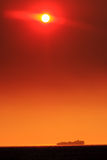 solnedgång för behållareship Fotografering för Bildbyråer