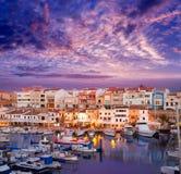 Solnedgång för Ciutadella Menorca marinaport med fartyg Fotografering för Bildbyråer