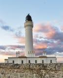 Solnedgång för Covesea fyrsommar. arkivfoton