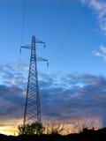 Solnedgång för elektricitetsmaktpylon Arkivfoto