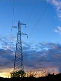 Solnedgång för elektricitetsmaktpylon Fotografering för Bildbyråer