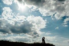 Solnedgång för himmel för kontur för parvänferie lycklig Fotografering för Bildbyråer