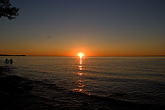 solnedgång för Kanada lakeontario simcoe arkivfoto
