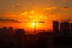 Solnedgång för konstruktionsplats Royaltyfria Bilder