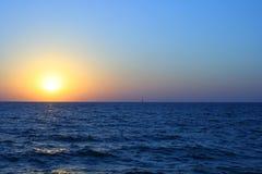 solnedgång för orange red Arkivbild