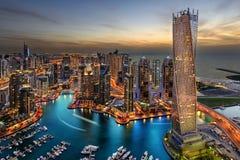 solnedgång för plats för cityscapedubai marina panorama- Royaltyfria Bilder
