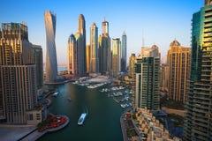 solnedgång för plats för cityscapedubai marina panorama- UAE royaltyfri fotografi