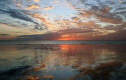 solnedgång för reflexion för strandbroomekabel Arkivfoto