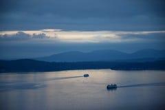 Solnedgång för Seattle utrymmevisare Arkivfoton
