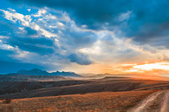 solnedgång för sky för aftonliggandehav arkivbild