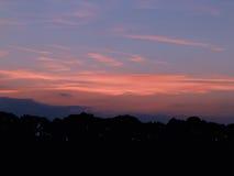 solnedgång för sky för aftonliggandehav Arkivfoton